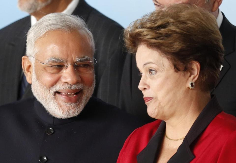 India's Prime Minister Narendra Modi (left) talked to Brazil's President Dilma Rousseff during a summit in Brasilia Wednesday. - REUTERS