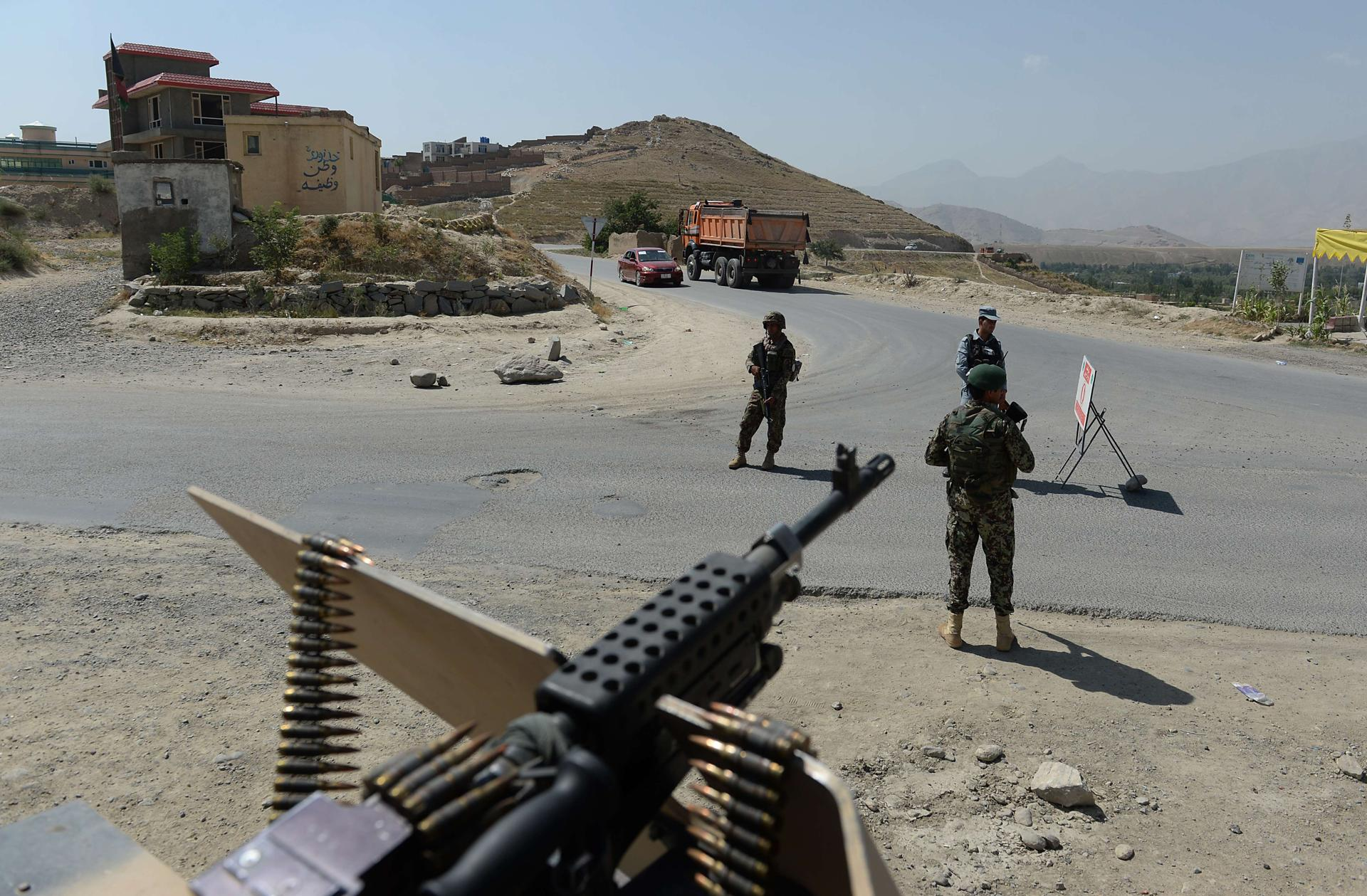Afghan National Army soldiers keep watch at a checkpoint on the outskirts of Kabul on Aug. 6.