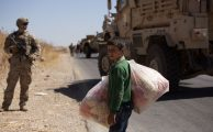 In September, a US soldier on a road in Syria as a boy carried snacks to sell in the so-called safe zone on the Syrian side of the border with Turkey. MAYA ALLERUZZO/AP